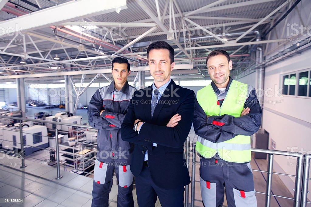 Manager and workers in factory stock photo