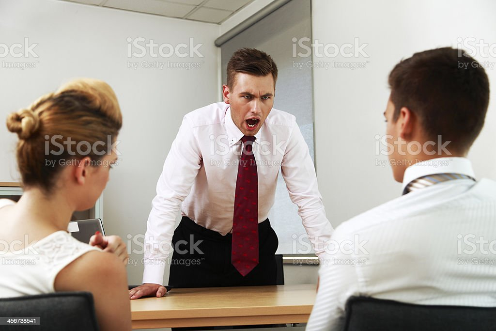 Manager angry at his coworkers stock photo