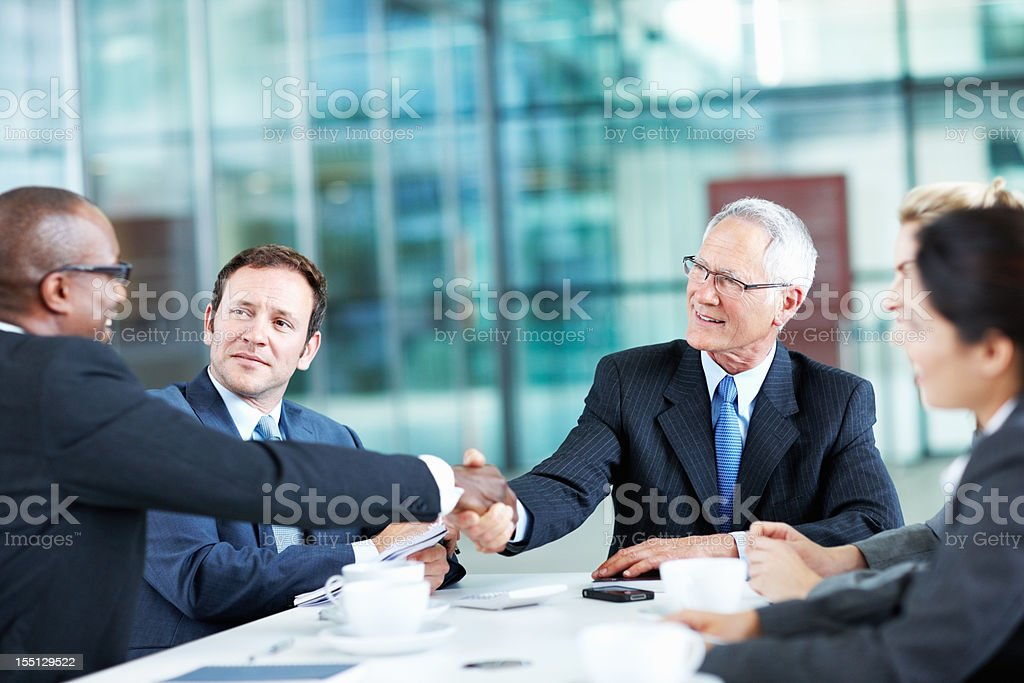 Manager being congratulated royalty-free stock photo