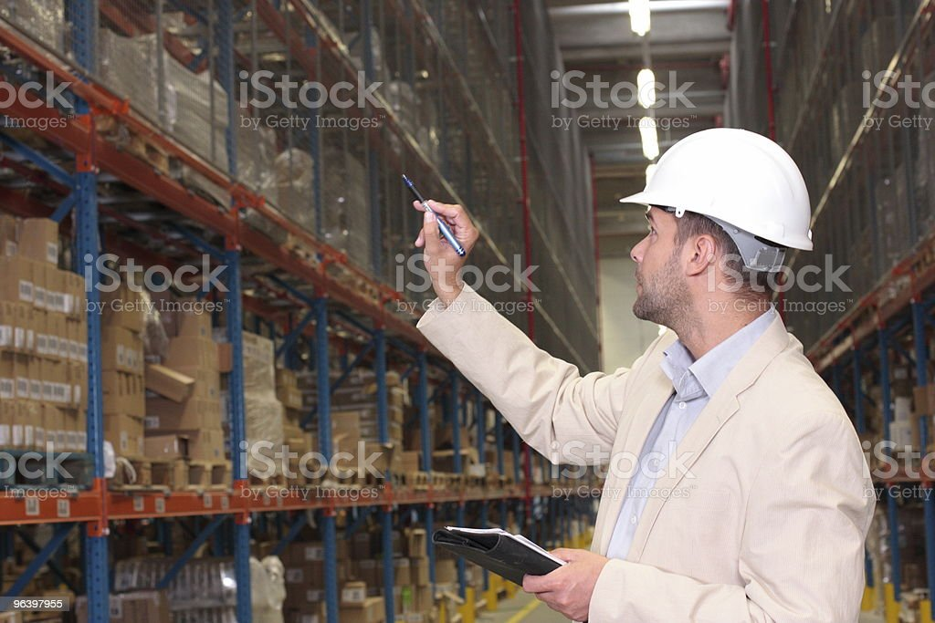 manager counting stocks in warehouse stock photo