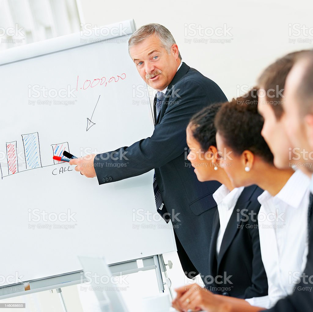 Manager explaining to his colleagues in a meeting royalty-free stock photo