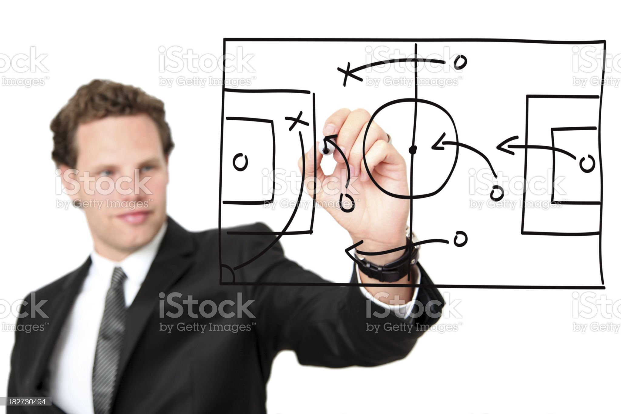 Manager illustrating a soccer strategy royalty-free stock photo