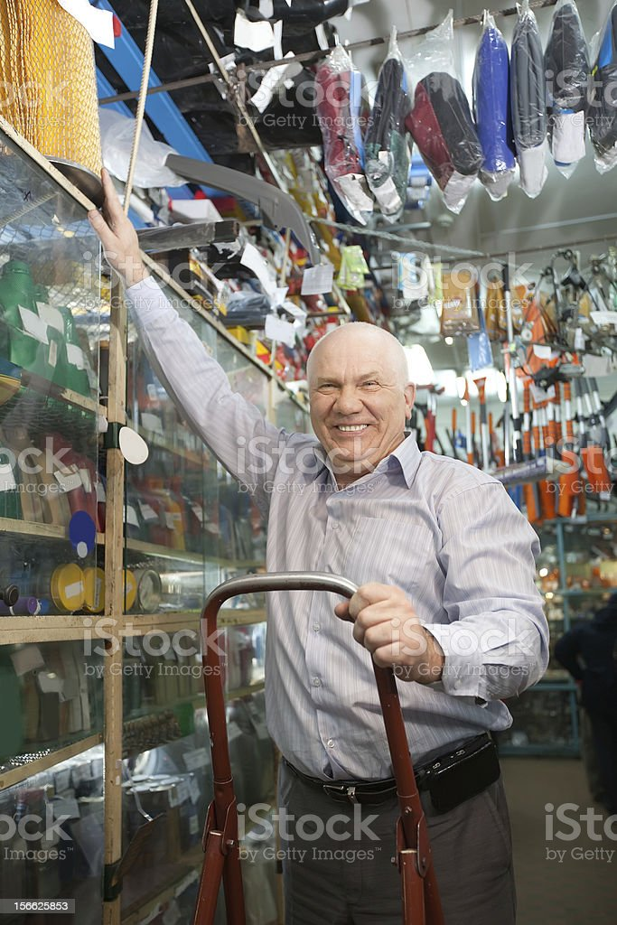 manager  in  auto parts store stock photo