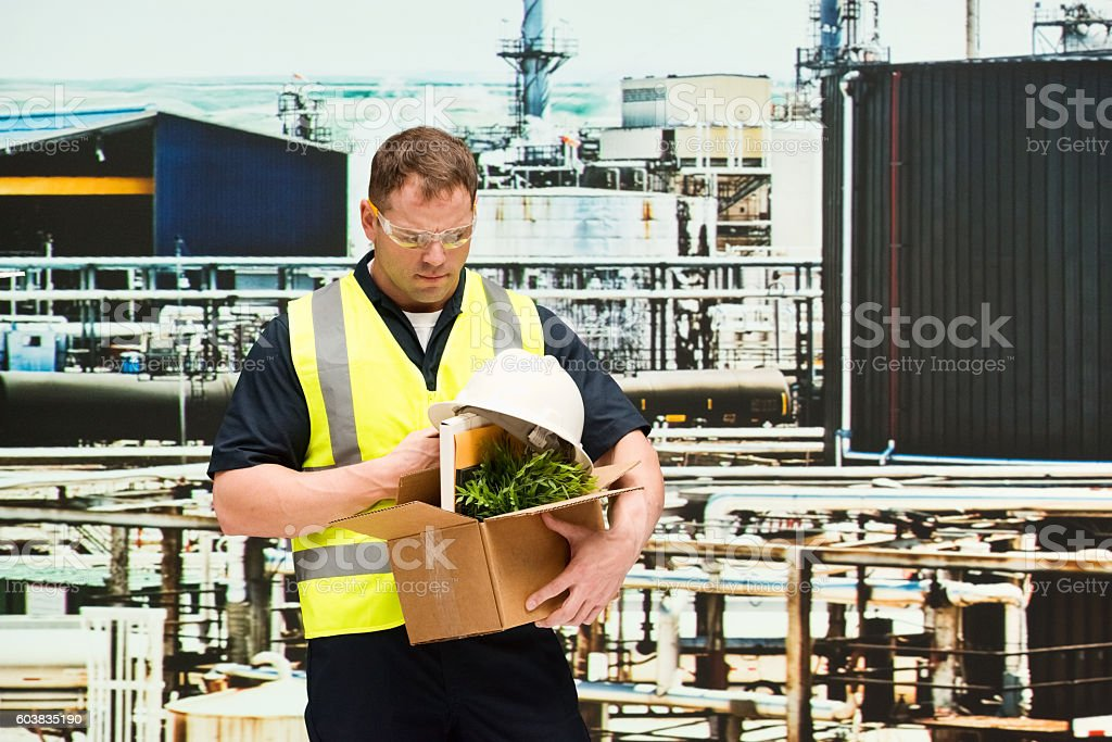 Manager in oil refinery and fired from his job stock photo