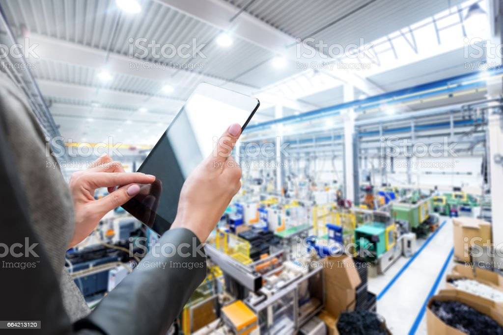 Manager in the factory & digital tablet stock photo