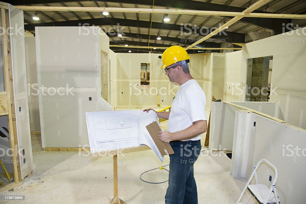 Manager inspecting Blueprints royalty-free stock photo