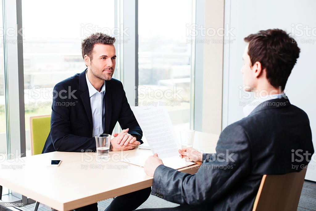 Manager interviewing a potential employee stock photo