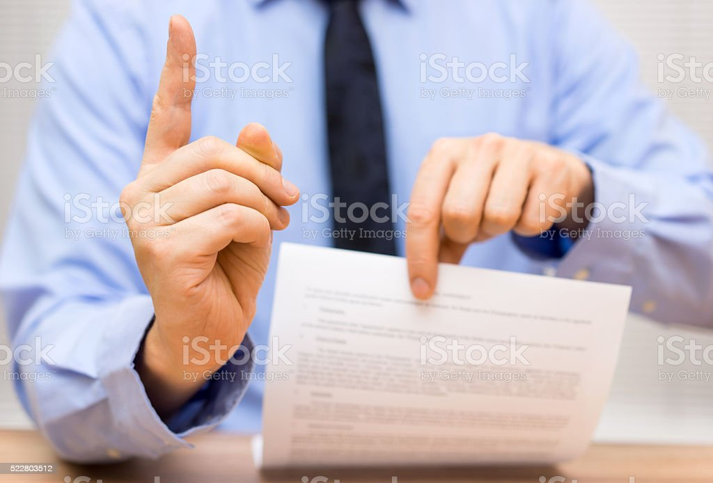 manager is angry at a colleague due to poor document stock photo