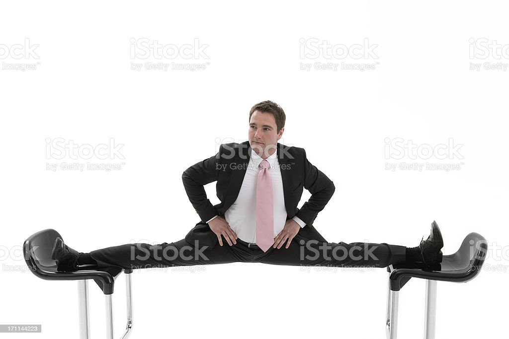 Manager is caught between two chairs stock photo