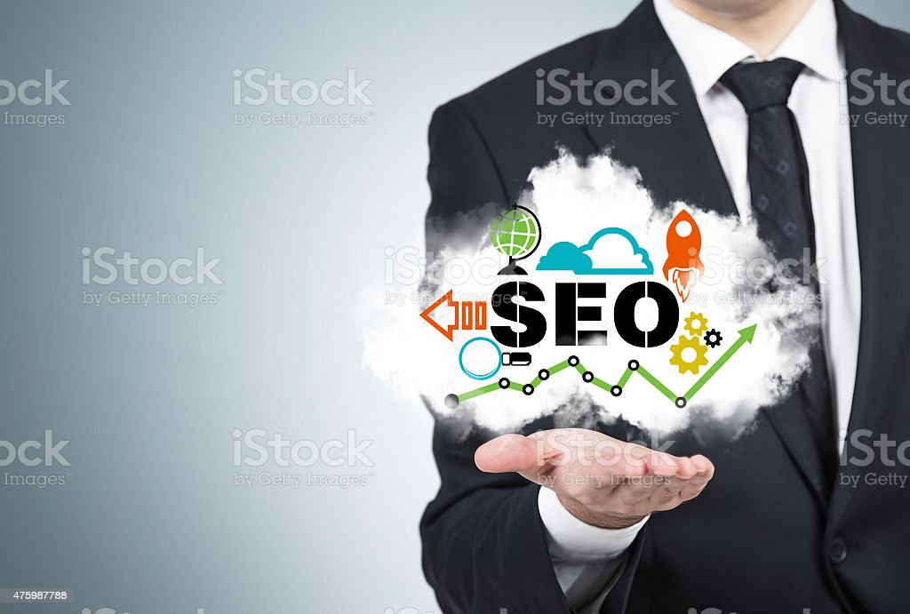 manager is holding a cloud with the SEO cloud. stock photo