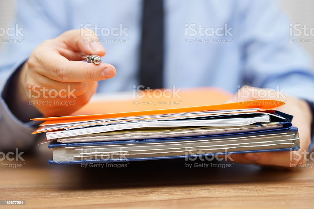 manager is offering pen and  documentation to begin with work stock photo
