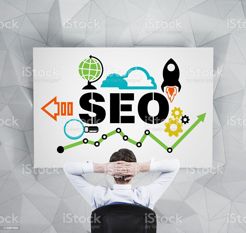Manager is pondering about implementation of the 'SEO' optimisation process. stock photo