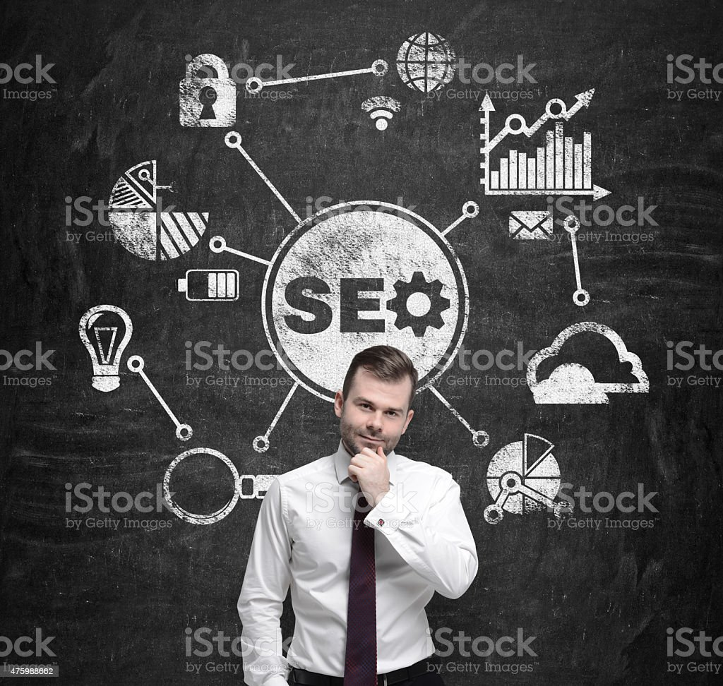 manager is pondering over the 'SEO' optimisation process. stock photo