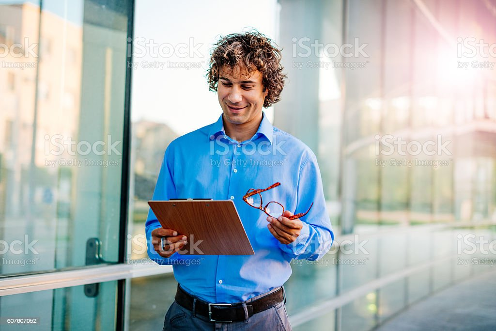 Manager is smiling while reading signed contract stock photo