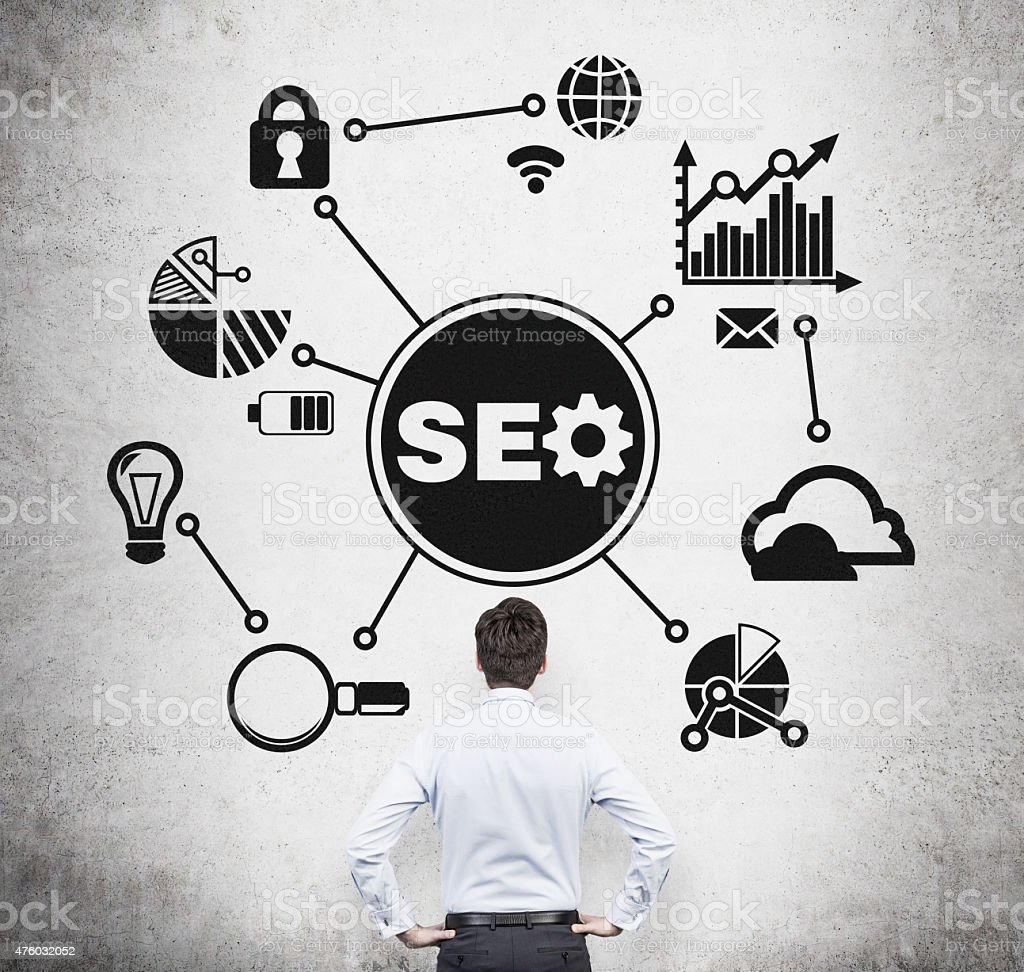 manager is thinking about 'SEO' optimisation process. stock photo