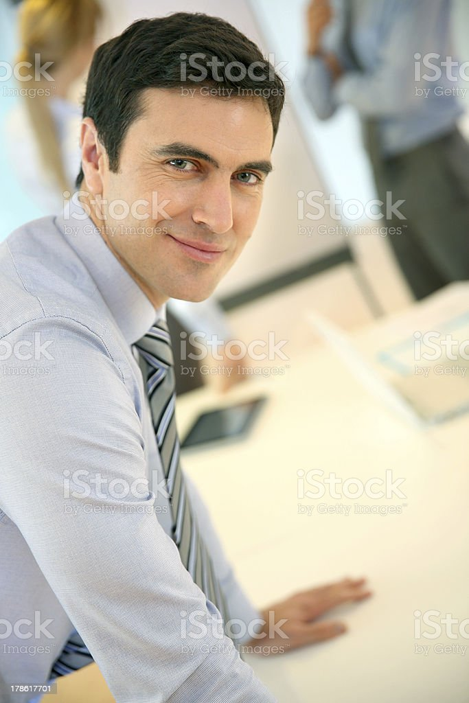 Manager leaning on table royalty-free stock photo