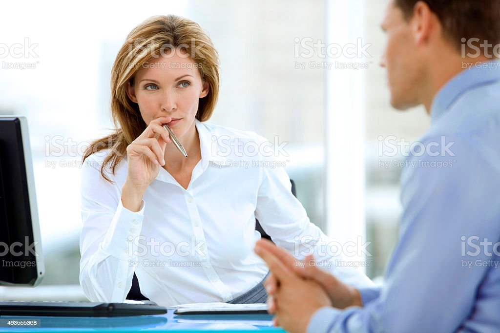 Manager listening to businessman stock photo