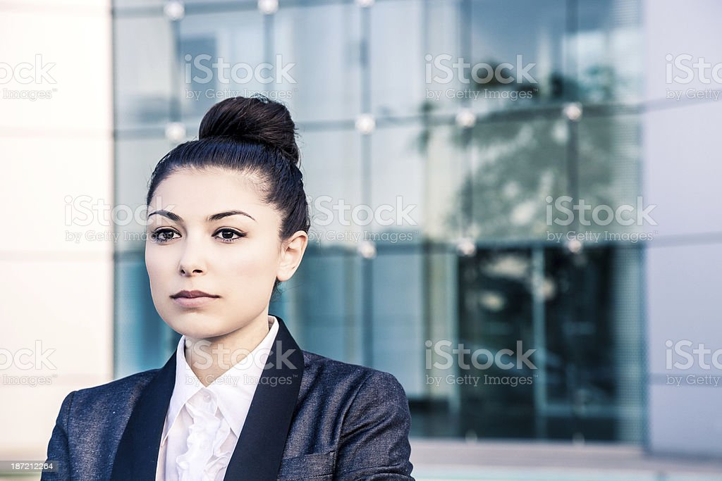 Manager looking away outside office buildings royalty-free stock photo