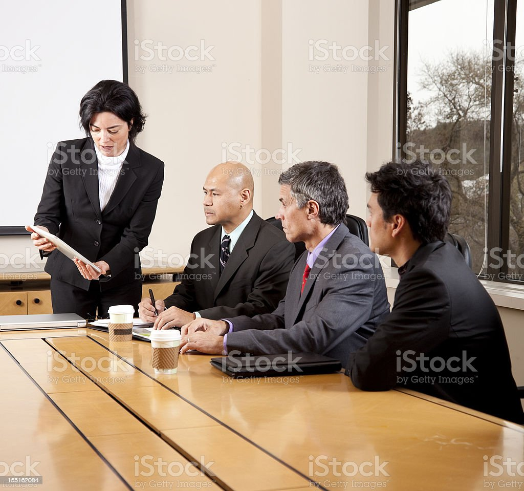 manager making presentation at conference table royalty-free stock photo
