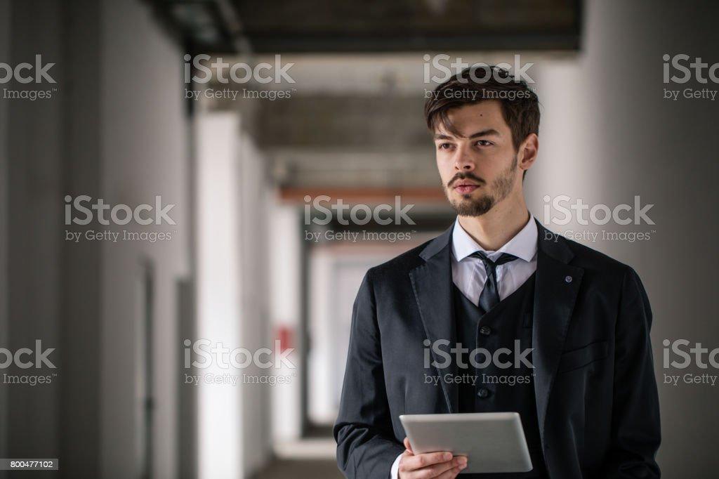 Manager man standing on stadium hallway stock photo
