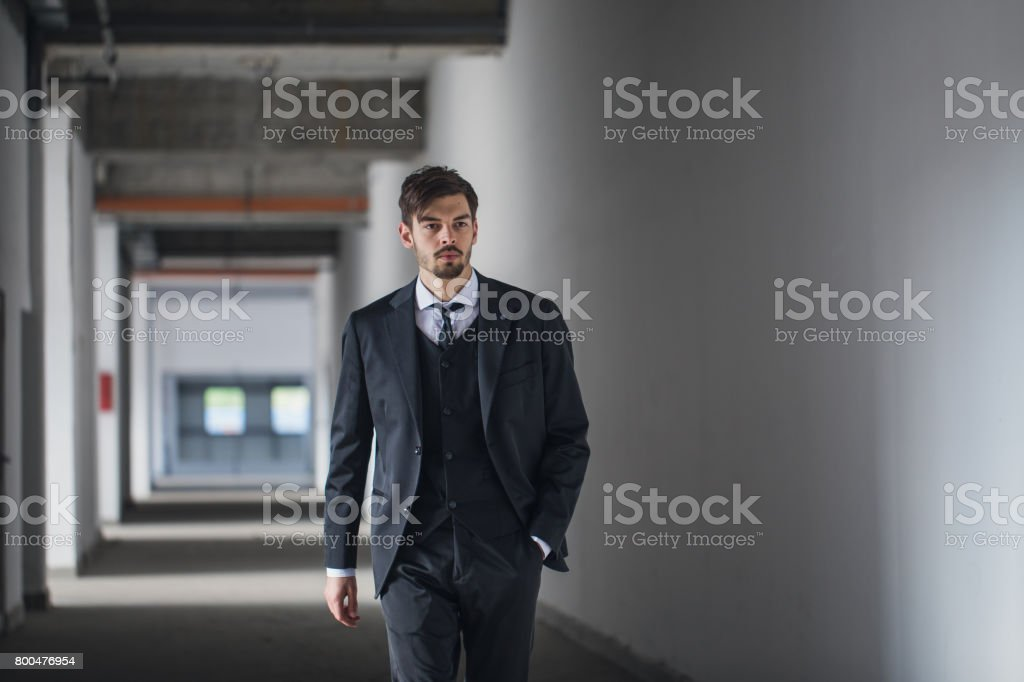 Manager man walking in stadium hallway stock photo
