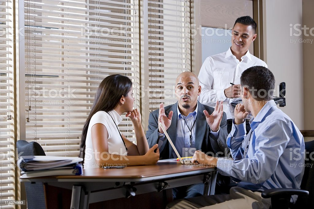 Manager meeting with office workers, directing royalty-free stock photo