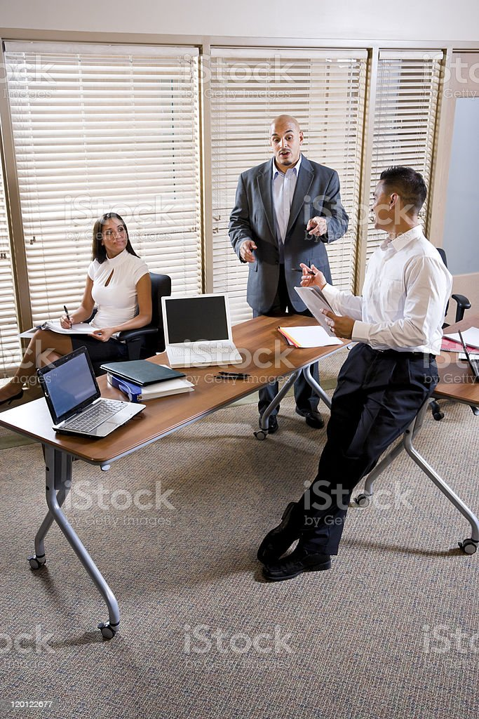 Manager meeting with office workers, directing stock photo