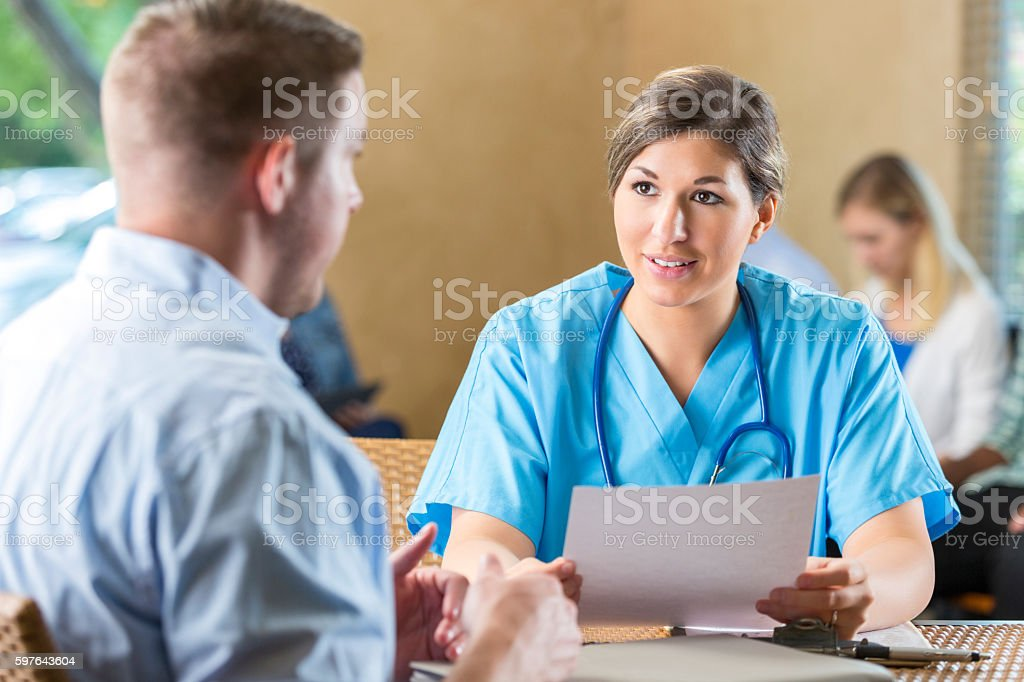 Manager of hospital nursing staff interviewing potential healthcare employee stock photo