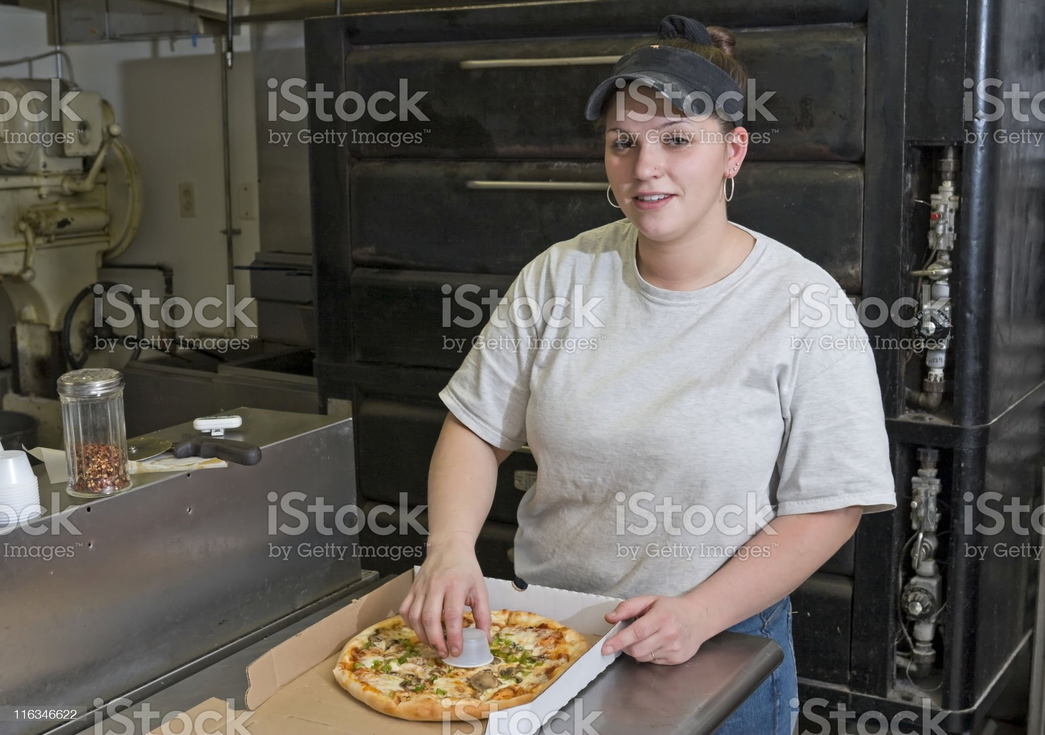 Manager Putting Pizza in a Box. royalty-free stock photo