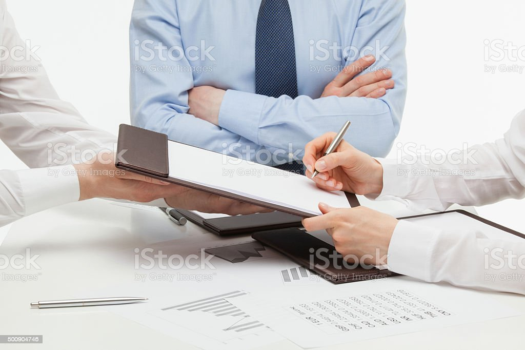 Manager signing a contract stock photo