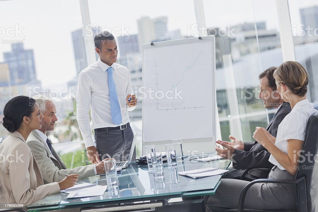Manager standing in front of colleagues stock photo