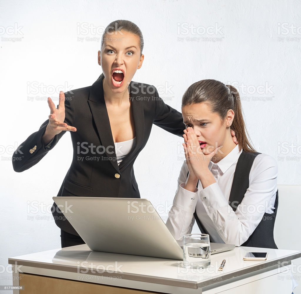 Manager teaches young employee stock photo