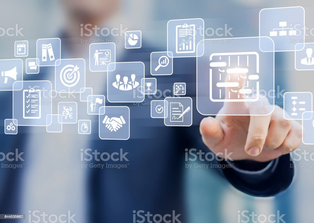 Manager touching AR screen interface, project management icons, scheduling, budgeting stock photo