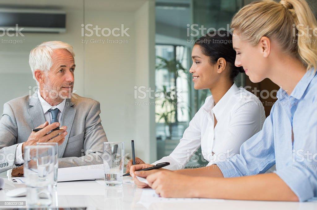Manager training new employees stock photo