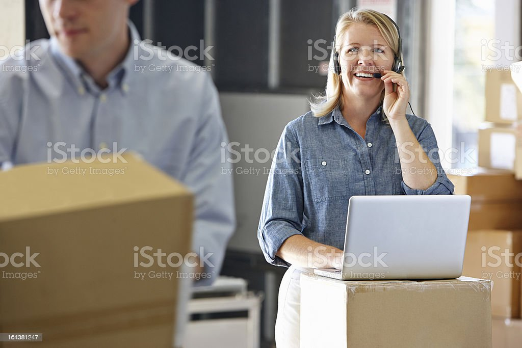 Manager Using Headset In Distribution Warehouse royalty-free stock photo