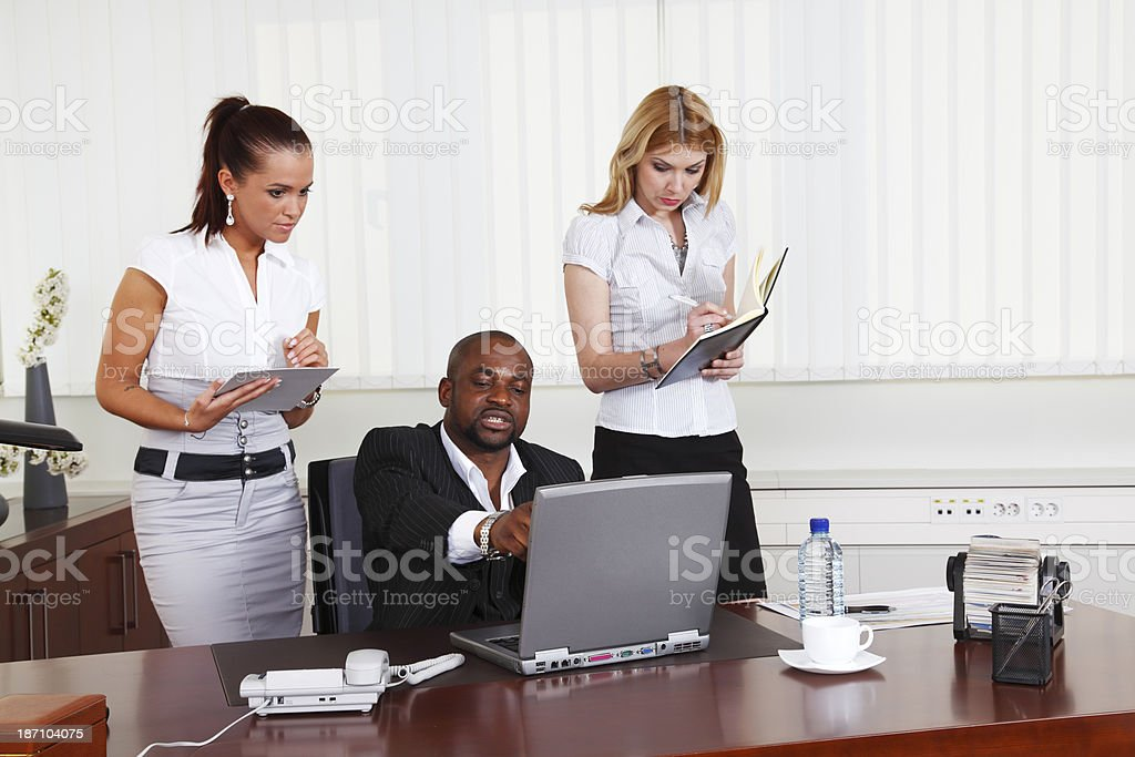 Manager with two secretaries royalty-free stock photo