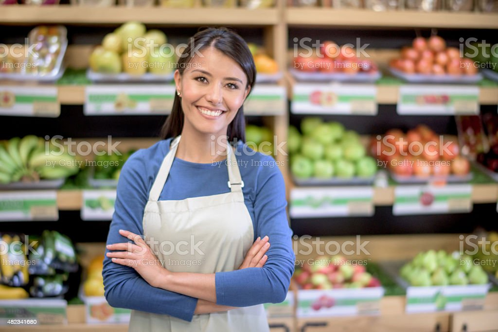 Manager working at a grocery store stock photo