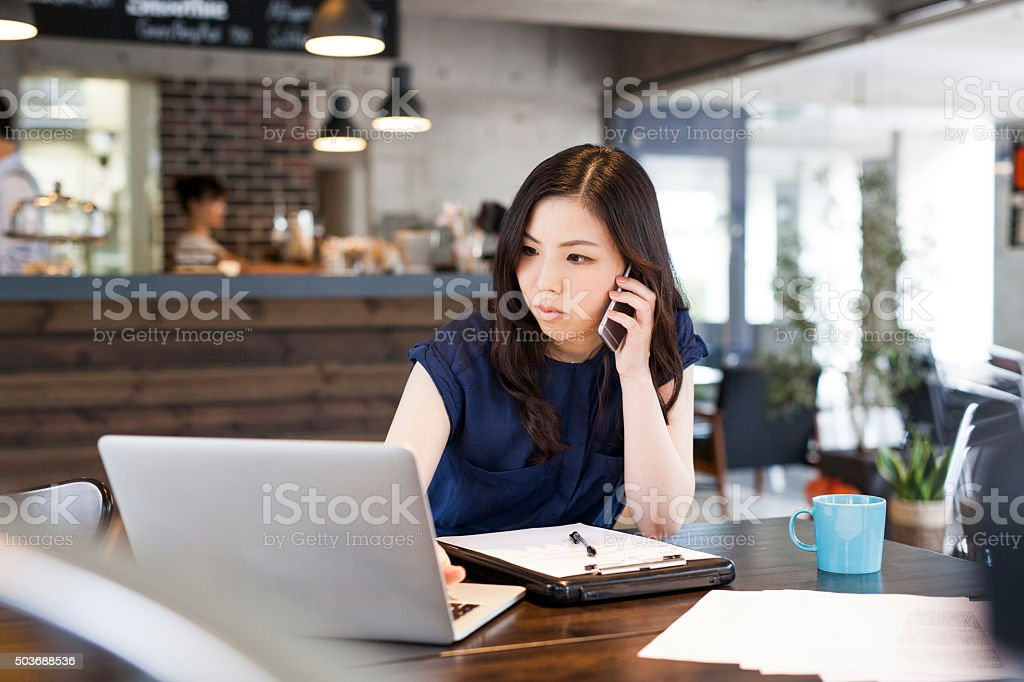 Manager Working at Cafe stock photo