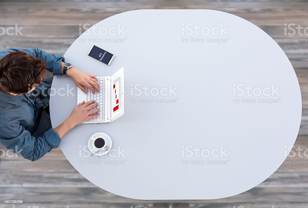 Manager Working on Computer at Grey Table stock photo
