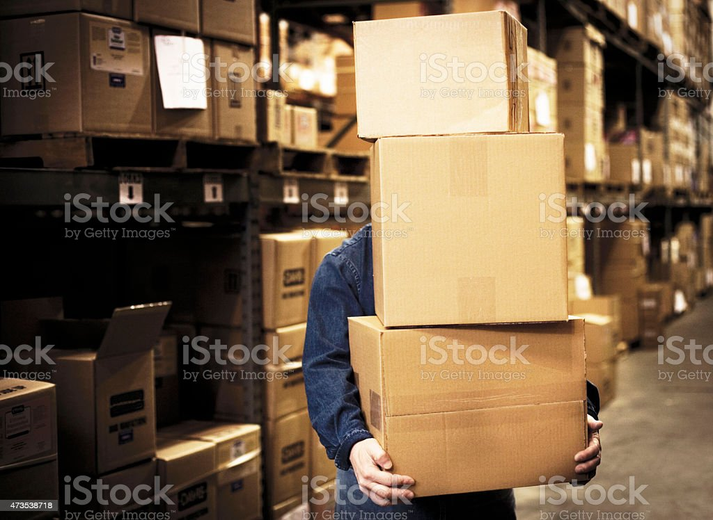 Manager working on computer in the warehouse. stock photo