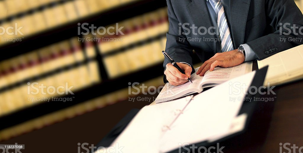 Manager writing at desk stock photo
