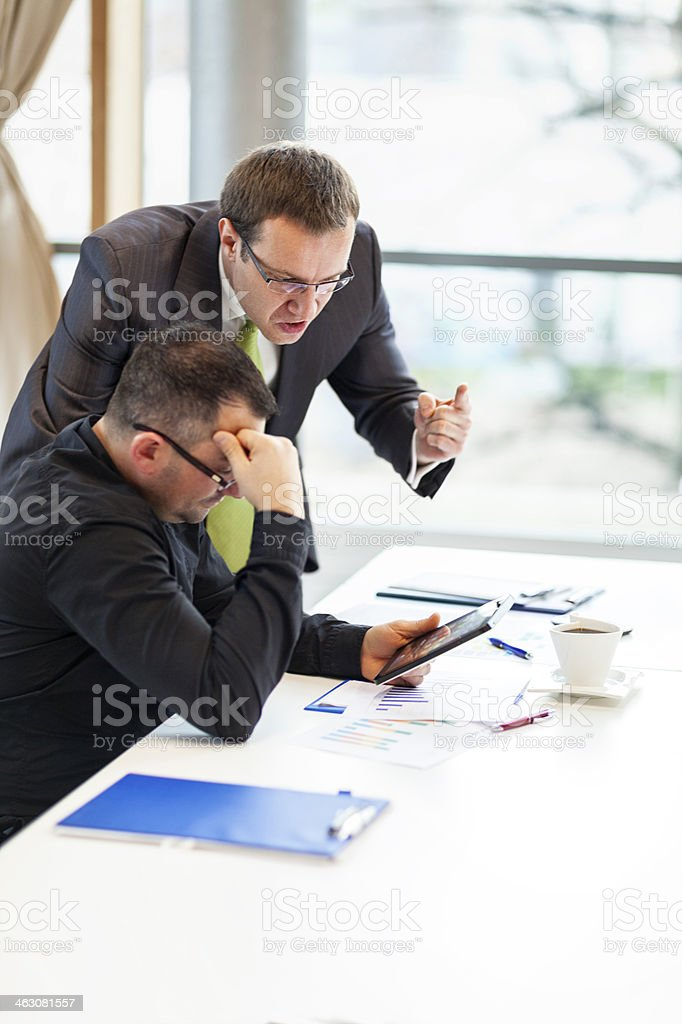 Manager yelling at his subordinate stock photo
