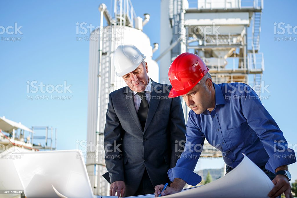 Managers at industrial facility stock photo
