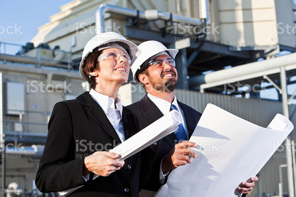 Managers at power generation facility royalty-free stock photo