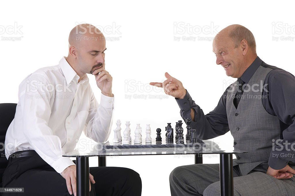 managers playing chess stock photo