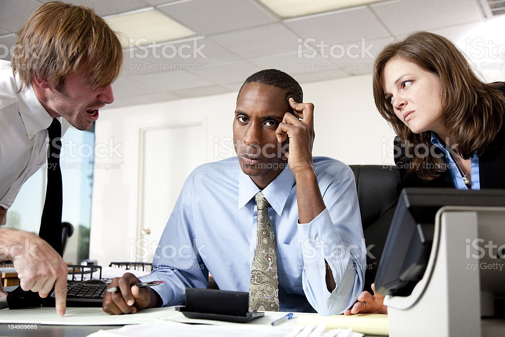 Managers scolding an employee royalty-free stock photo