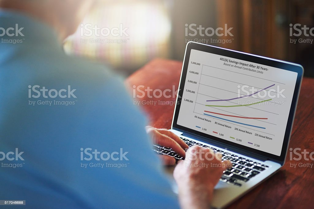 Managing his retirement plan with modern technology stock photo
