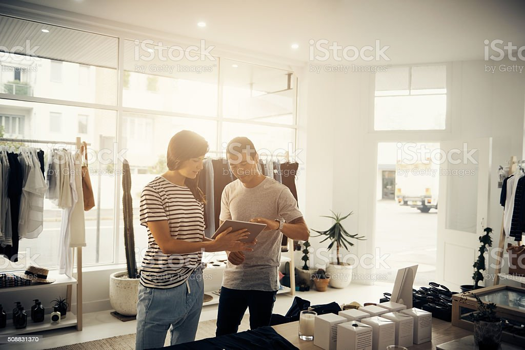 Managing their boutique the modern way stock photo