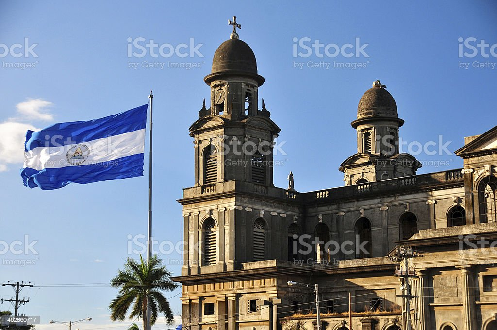 Managua, Nicaragua: Old Cathedral and Nicaraguan flag stock photo