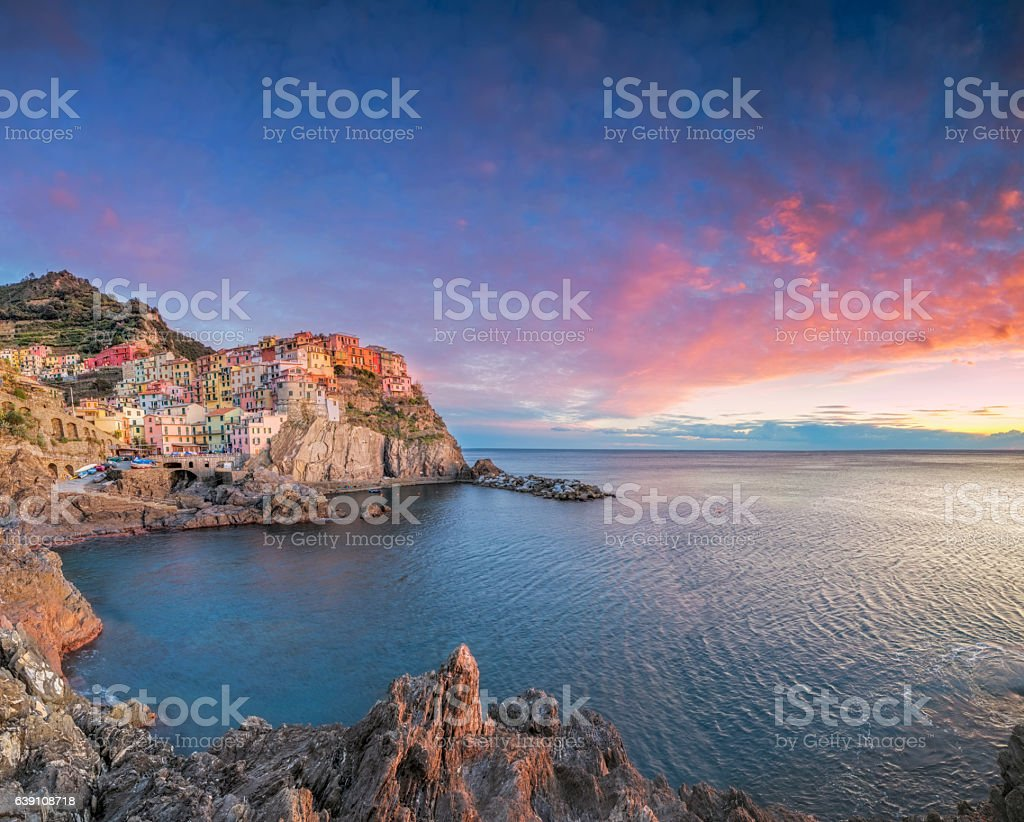 Manarola at sunset, Cinque Terre National Park, Ligurian Riviera, Italy stock photo